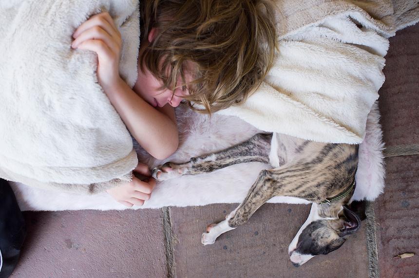 Felix asleep with dog. With friends in San Jose de los Laureles, Tlayacapan, Morelos, Mexico