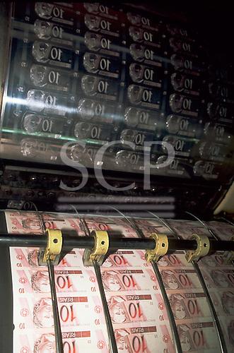Rio de Janeiro, Brazil. Printing press producing 10 Reais currency notes at the official mint printer - Casa da Moeda.