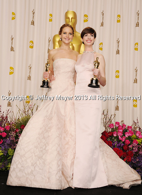 HOLLYWOOD, CA - FEBRUARY 24: Jennifer Lawrence and Anne Hathaway pose in the press room the 85th Annual Academy Awards at Dolby Theatre on February 24, 2013 in Hollywood, California.