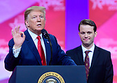 United States President Donald J. Trump with Hayden Williams, a conservative activist who was filmed being punched on the campus of the University of California Berkley, on the stage as he speaks at the Conservative Political Action Conference (CPAC) at the Gaylord National Resort and Convention Center in National Harbor, Maryland on Saturday, March 2, 2019.<br /> Credit: Ron Sachs / CNP <br /> (RESTRICTION: NO New York or New Jersey Newspapers or newspapers within a 75 mile radius of New York City)