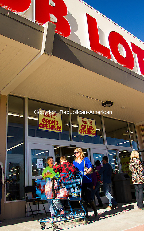 TORRINGTON, CT - 19 NOVEMBER 2016 - 111916JW04.jpg -- Jane White of Torrington with daughter Priscilla Arcamone and grandson Jesse Arcamone exit the newly opened Ocean State Job Lot with their purchases Saturday morning in the space formerly occupied by Kmart.    Jonathan Wilcox Republican-American