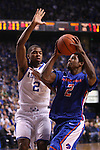 UK guard Aaron Harrison attempts to block Boise State guard Derrick Marks during the first half of the University of Kentucky men's basketball game vs. Boise State at Rupp Arena in Lexington, Ky., on Tuesday, December, 10, 2013. Photo by Jonathan Krueger | Staff