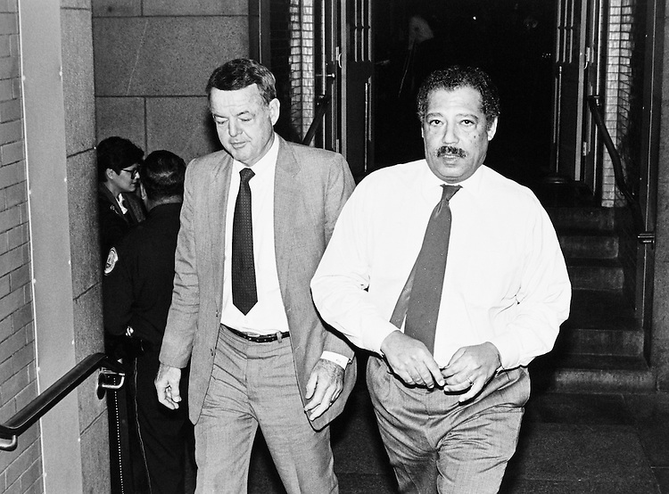 Rep. Michael Myers, D-Pa. and Rep. Julian C. Dixon, D-Calif. outside of the Ethics Committee room, which has been staked-out by reporters. October 19, 1989. (Photo by Laura Patterson/CQ Roll Call)