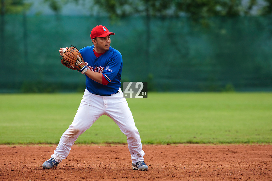 03 June 2010: Juan Manuel Salazar of C.B. Sant Boi throws the ball to first base during the 2010 Baseball European Cup match won  8-4 by C.B. Sant Boi over the Rouen Huskies, at the Kravi Hora ballpark, in Brno, Czech Republic.