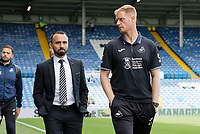 LEEDS, ENGLAND - AUGUST 31: (L-R) Leon Britton and Alan Tate of Swansea arrive prior to the game during the Sky Bet Championship match between Leeds United and Swansea City at Elland Road on August 31, 2019 in Leeds, England. (Photo by Athena Pictures/Getty Images)