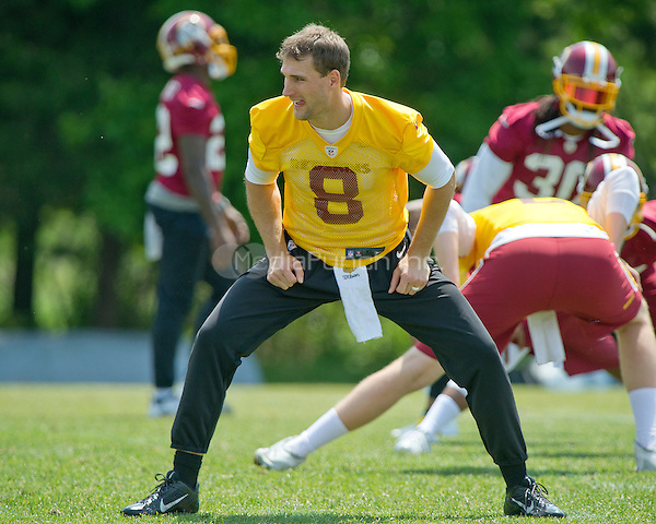Washington Redskins quarterback Kirk Cousins (8) participates in warm-up drills during an organized team activity (OTA) at Redskins Park in Ashburn, Virginia on Wednesday, May 25, 2015.<br /> Credit: Ron Sachs / CNP/MediaPunch ***FOR EDITORIAL USE ONLY***