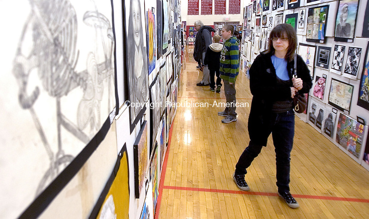 (COUNTRYLIFE USE ONLY)<br /> SOUTHBURY CT. 26 April 2014-042617SV14-Tracey Cassidy of Middlebury checks out the artwork during the Region 15 art show at Pomperaug High in Southbury Saturday.<br /> Steven Valenti Republican-American