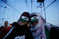 New York City, NY. 20 August 2014. two women pose for a picture as they take part during a Pro-palestine Rally across de Brooklyn Bridge in Manhattan.  Photo by Kena Betancur/VIEWpress