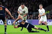 Nathan Hughes of England is tackled by Guilhem Guirado of France. RBS Six Nations match between England and France on February 4, 2017 at Twickenham Stadium in London, England. Photo by: Patrick Khachfe / Onside Images