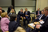 Copenhagen, Denmark - December 18, 2009 -- President Nicolas Sarkozy of France pats United States President Barack Obama on the shoulder during a briefing with European leaders, including Prime Minister Gordon Brown of Great Britain, Prime Minister Fredrik Reinfeldt of Sweden, Chancellor Angela Merkel of Germany, European Union Commission President Jose Manuel Barroso, and Prime Minister Lars L. Rasmussen of Denmark following a multilateral meeting at the United Nations Climate Change Conference in Copenhagen, Denmark, Friday, December 18, 2009..Mandatory Credit: Pete Souza - White House via CNP