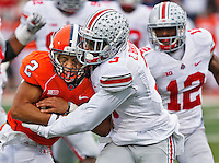 Illinois Fighting Illini quarterback Nathan Scheelhaase (2) winces as he his tackled by Ohio State Buckeyes defensive back Corey Brown (3) in the second half at Memorial Stadium in Champaign, Illinois on November 16, 2013.  (Chris Russell/Dispatch Photo)