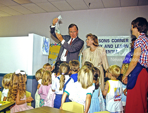 United States Vice President George H.W. Bush visits a day care center in Tysons Corner, Virginia on July 29, 1988.<br /> Credit: Howard L. Sachs / CNP