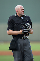 Home plate umpire Rich Grassa between innings of the Carolina League game between the Salem Red Sox and the Winston-Salem Dash at BB&T Ballpark on June 18, 2015 in Winston-Salem, North Carolina.  The Red Sox defeated the Dash 8-2.  (Brian Westerholt/Four Seam Images)