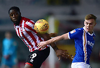Lincoln City's John Akinde vies for possession with Exeter City's Archie Collins<br /> <br /> Photographer Andrew Vaughan/CameraSport<br /> <br /> The EFL Sky Bet League Two - Lincoln City v Exeter City - Tuesday 26th February 2019 - Sincil Bank - Lincoln<br /> <br /> World Copyright © 2019 CameraSport. All rights reserved. 43 Linden Ave. Countesthorpe. Leicester. England. LE8 5PG - Tel: +44 (0) 116 277 4147 - admin@camerasport.com - www.camerasport.com