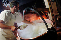 Making Zigger (a form of curd cheese) from the remaining whey...Cowherd and cheesemaker spends 100 days in the summer, high up in the mountains, tending cows and pigs and making cheese at Balisalp and Käserstatt near Meiringen, Switzerland.