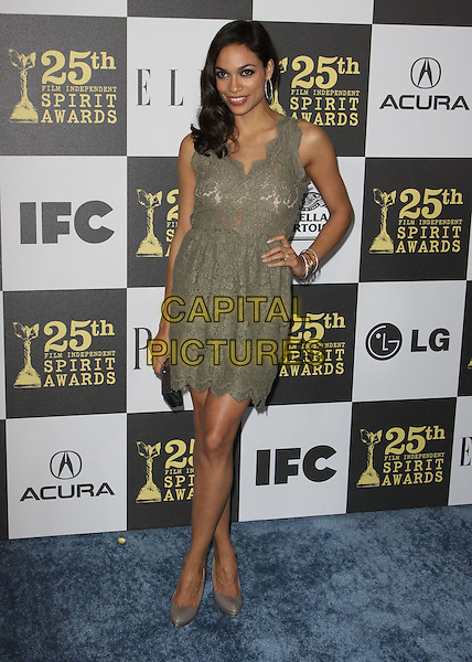 ROSARIO DAWSON .25th Annual Film Independent Spirit Awards held At The Nokia LA Live, Los Angeles, California, USA,.March 5th, 2010 ..arrivals Indie Spirit full length green dress lace sleeveless hand on hip clutch bag smiling grey gray shoes .CAP/ADM/KB.©Kevan Brooks/Admedia/Capital Pictures