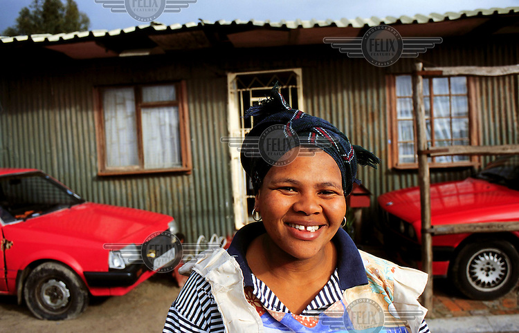Vicky Ntozini, who runs Vicky's B&B in Khayelitsha Township, which caters for tourists on 'township tours', outside her small township shack.