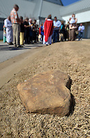 NWA Democrat-Gazette/BEN GOFF -- 03/29/15 The Rev. Pamela Morgan leads her congregation through the Stations of the Cross, using stones carved by her son Nathan Morgan marking the stations, following Palm Sunday service at St. Thomas Episcopal Church in Springdale on Sunday Mar. 29, 2015.