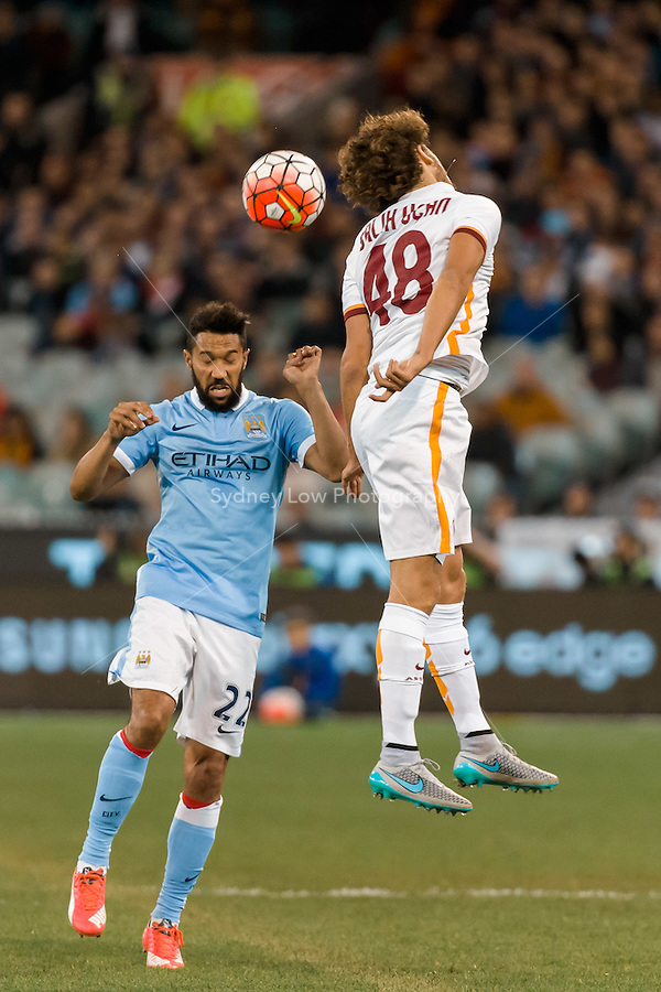 Melbourne, 21 July 2015 - Salih Uçan of AS Roma jumps for the ball in game two of the International Champions Cup match at the Melbourne Cricket Ground, Australia. City def Roma 5-4 in Penalties. (Photo Sydney Low / AsteriskImages.com)