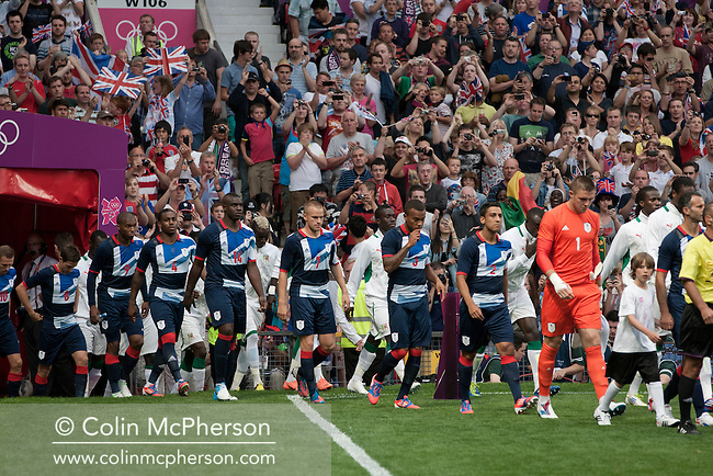 Great Britain football team walking onto the field at Manchester United's Old Trafford stadium prior to their team's opening Men's Olympic Football tournament match at the venue. The double header of matches resulted in Uruguay defeating the United Arab Emirates by 2-1 while Great Britain and Senegal drew 1-1. Over 72,000 spectators attended the two Group A matches.