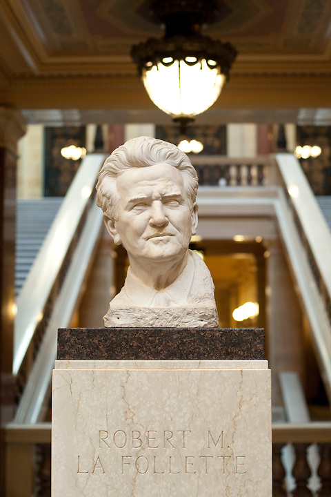 "On Sunday, March 13, 2011, in Madison, Wis., a bust of late Wisconsin Senator Robert ""Fighting Bob"" La Follette is pictured at the Wisconsin State Capitol after more than 30 people with People Organizing Wisconsin for Education and workers' Rights (P.O.W.E.R.) celebrate arrival to the building following the final leg of the group's three-day, 84-mile P.O.W.E.R. Walk from Milwaukee to Madison. With the number of joining participants swelling at times, the group marched in protest of a controversial collective bargaining bill signed by Wisconsin Gov. Scott Walker on March 11. The bill, which requires state employees to make higher contributions to their pensions and health insurance premiums, and that substantially cuts collective bargaining rights for union workers, was originally part of a broader budget repair bill. (Photo by Jeff Miller for SEIU)"
