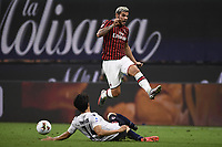 Takehiro Tomiyasu of Bologna FC and Theo Hernandez of AC Milan compete for the ball during the Serie A football match between AC Milan and Bologna FC at stadio Giuseppe Meazza in Milano ( Italy ), July 18th, 2020. Play resumes behind closed doors following the outbreak of the coronavirus disease. <br /> Photo Image Sport / Insidefoto
