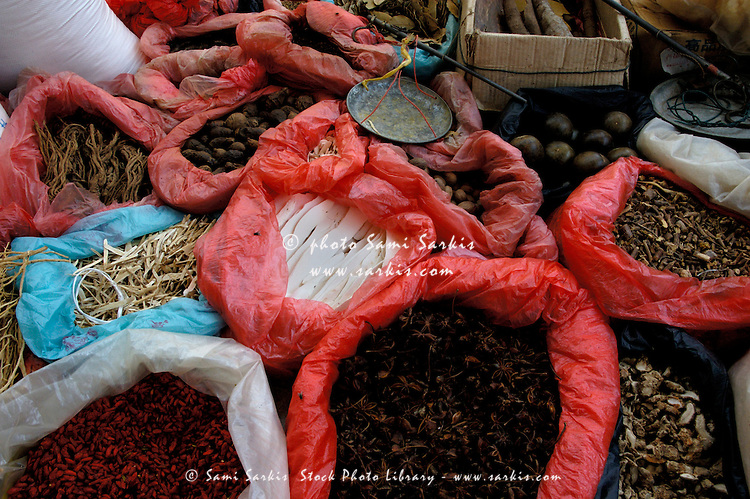 Dried vegetables, fruits, and spices for sale at the weekly food market in Fuli village, Yangshuo, Guangxi, China.