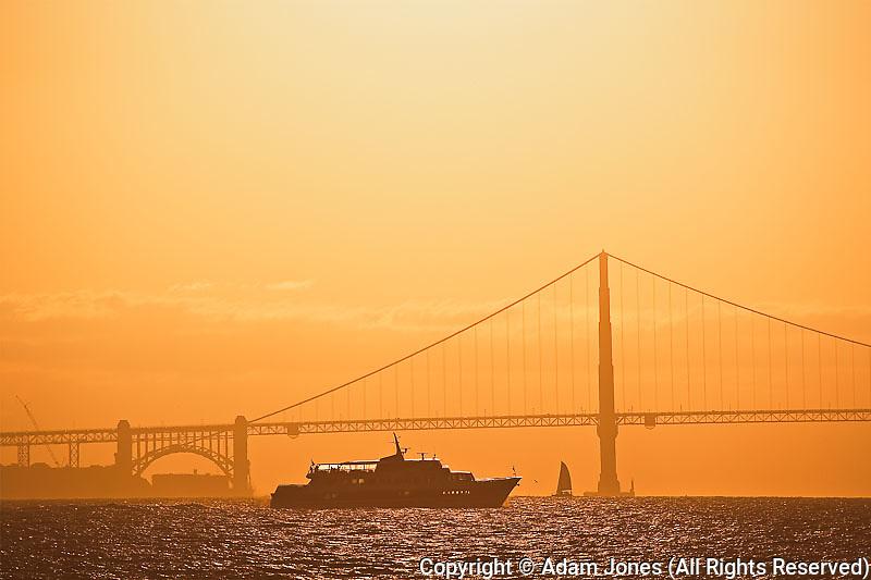 Tour boat and Golden Gate Bridge at sunet, San Franciso, California