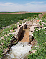The Amity Canal near Holly, Colorado, Friday, May 20, 2016. Thompson Farms, a large farming operation, hold junior water rights to irrigate with water diverted from the Arkansas River through the Amity Canal.<br /> <br /> Photo by Matt Nager
