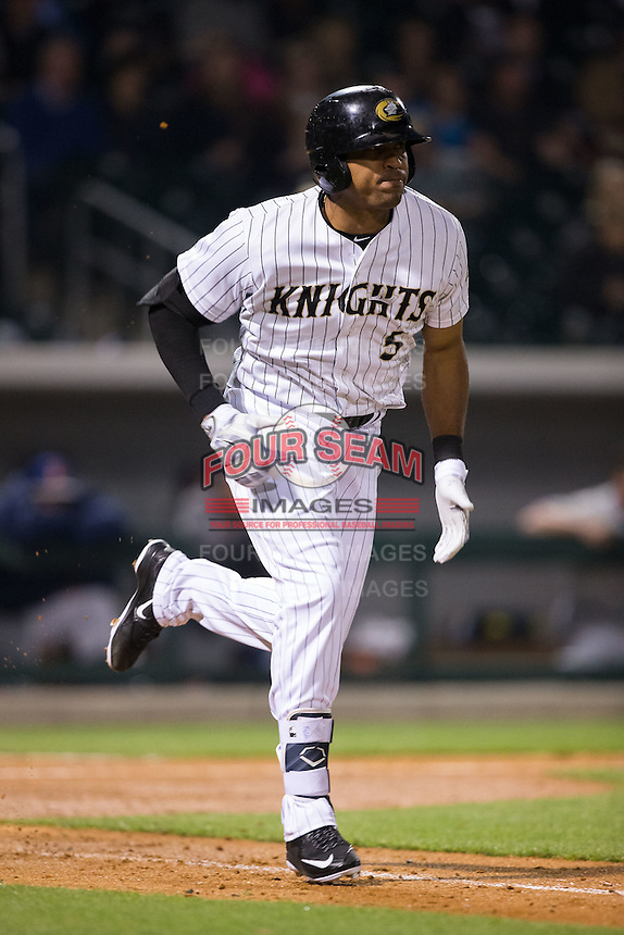 Daniel Fields (5) of the Charlotte Knights hustles down the first base line against the Durham Bulls at BB&T BallPark on April 14, 2016 in Charlotte, North Carolina.  The Bulls defeated the Knights 2-0.  (Brian Westerholt/Four Seam Images)