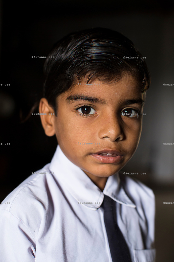 Hemant Jat, 6, at home in Maheshwar, Khargone, Madhya Pradesh, India on 13 November 2014. Hemant, the son of a Fairtrade cotton farmer, wants to be a police man when he grows up and gets a 5% discount of school fees at the Vasudha school. His father Nandaram would be happy if Hemant took over the farm but if he does well in school, he could look for other careers. Photo by Suzanne Lee for Fairtrade