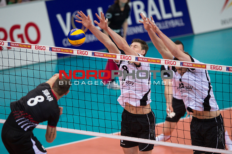 05.01.2014, MHP Arena, Ludwigsburg<br /> Volleyball, Qualifikation WM 2014, Deutschland vs. T&uuml;rkei / Tuerkei<br /> <br /> Angriff Burutay Subasi (#8 TUR) - Block / Doppelblock Marcus B&ouml;hme / Boehme (#8 GER), Christian Fromm (#1 GER)<br /> <br />   Foto &copy; nordphoto / Kurth