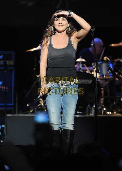 "GRETCHEN WILSON.Performs live and showcased her new upcoming Album  ""I Got Your Country Right Here"" held at the Grove of Anaheim in Anaheim, California, USA. .March 10th, 2010.stage concert live gig performance music full length black sleeveless vest tank top jeans denim hand .CAP/RKE/DVS.©DVS/RockinExposures/Capital Pictures."