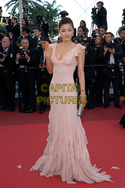 GIANNA JUN.'The Artist'  premiere at the Palais des Festivals  Cannes, 64th International Cannes Film Festival, France.15th May 2011..full length pale pink beige long maxi dress ruffle silver clutch bag hand waving .CAP/PL.©Phil Loftus/Capital Pictures.