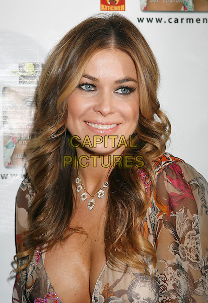 "CARMEN ELECTRA.Carmen Electra Launches the ""Carmen Electra Prepaid MasterCard"" held at Red Pearl Kitchen, Hollywood, California, USA..October 25th, 2006.Ref: ADM/RE.headshot portrait beige pattern necklace cleavage.www.capitalpictures.com.sales@capitalpictures.com.©Russ Elliot/AdMedia/Capital Pictures."