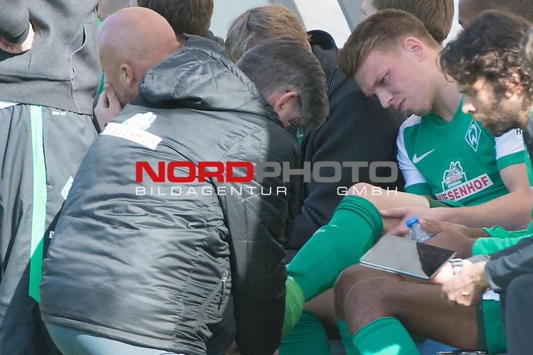 15.01.2016, Kaya Palazzo, Belek, TUR, FSP, Werder Bremen (GER) vs Inter BAKU (AZE),  <br /> im Bild <br /> <br /> Janek Sternberg (Bremen #37) liegt verletzt am Boden Dr. Philip Heitmann (Mannschaftsarzt Werder Bremen) Sven Plagge (Physiotherapeut Werder Bremen) bringen ihn vom platz wird dann von Holger Berger (Physiotherapeut Werder Bremen) versorgt <br /> Verletzung / verletzt / Schmerzen<br /> <br /> <br /> Foto &copy; nordphoto / Kokenge