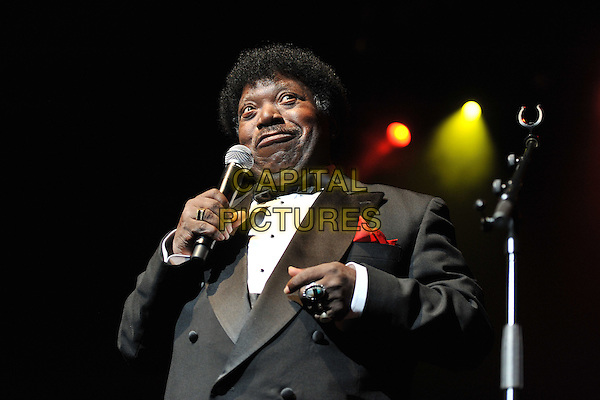 Percy Sledge.Performing live at Vintage 2011, Royal Festival Hall, London, England, UK, .30th July 2011..music half length  on stage microphone singing white shirt grey gray suit tuxedo tux bow tie black concert gig funny .CAP/MAR.© Martin Harris/Capital Pictures.