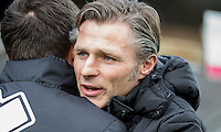 Wycombe Wanderers Manager Gareth Ainsworth embraces the Bristols Rovers Manager during the Sky Bet League 2 match between Wycombe Wanderers and Bristol Rovers at Adams Park, High Wycombe, England on 27 February 2016. Photo by Andrew Rowland.