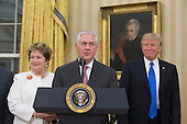 Rex Tillerson (C) delivers remarks after being sworn-in as Secretary of State, beside his wife Renda St. Clair (L), and US President Donald J. Trump (R) in the Oval Office of the White House in Washington, DC, USA, 01 February 2017. Tillerson was confirmed by the Senate, 01 February, in a 56-to-43 vote to become the nation's 69th Secretary of State.<br /> Credit: Michael Reynolds / Pool via CNP