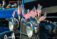 Detail of a classic ford car with American flags.