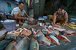 A man and woman sell fish in the Tahan Market in Kalay, a town in Myanmar. This market is located in Tahan, the largely ethnic Chin section of the town.