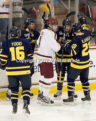 Jesse Todd (Merrimack - 16), Jeff Velleca (Merrimack - 28), Tommy Cross (BC - 4), Jordan Heywood (Merrimack - 4), Ryan Flanigan (Merrimack - 20) - The Boston College Eagles defeated the Merrimack College Warriors 4-2 to give Head Coach Jerry York his 900th collegiate win on Friday, February 17, 2012, at Kelley Rink at Conte Forum in Chestnut Hill, Massachusetts.
