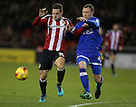 Billy Sharp of Sheffield Utd tussles with Brian Wilson of Oldham during the English League One match at Bramall Lane Stadium, Sheffield. Picture date: December 26th, 2016. Pic Simon Bellis/Sportimage