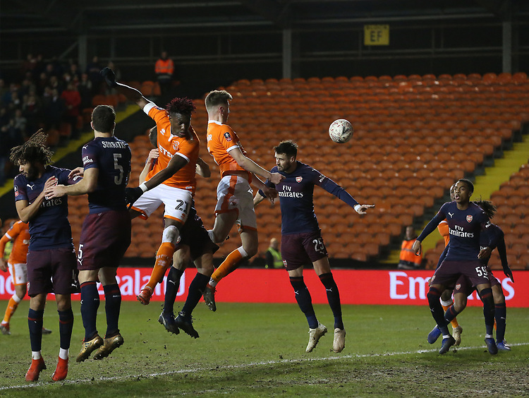 as (L to R) Arsenal's Sokratis Papastathopoulos, Stephan Lichtsteiner and Carl Jenkinson all fail to prevent  Blackpool's Paudie O'Connor heading just over the bar, watched by team-mate Nathan Delfouneso<br /> <br /> Photographer Stephen White/CameraSport<br /> <br /> Emirates FA Cup Third Round - Blackpool v Arsenal - Saturday 5th January 2019 - Bloomfield Road - Blackpool<br />  <br /> World Copyright &copy; 2019 CameraSport. All rights reserved. 43 Linden Ave. Countesthorpe. Leicester. England. LE8 5PG - Tel: +44 (0) 116 277 4147 - admin@camerasport.com - www.camerasport.com