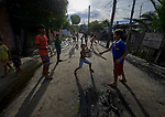 Indigenous children play in the street in the Nacoes Indigenas neighborhood in Manaus, Brazil. The neighborhood is home to members of more than a dozen indigenous groups, many of whose members have migrated to the city in recent years from their homes in the Amazon forest.