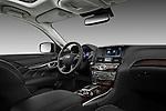 Passenger side dashboard view of a 2012 Infiniti M Hybrid.