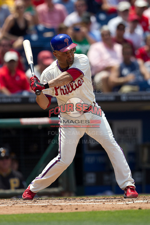 Philadelphia Phillies third baseman Placido Polanco #27 swings during the Major League Baseball game against the Pittsburgh Pirates on June 28, 2012 at Citizens Bank Park in Philadelphia, Pennsylvania. The Pirates defeated the Phillies 5-4. (Andrew Woolley/Four Seam Images).