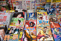 Magazines on sale in traditional old Chinese district, near Des Voeux Road, Sheung Wan, Hong Kong Island, China