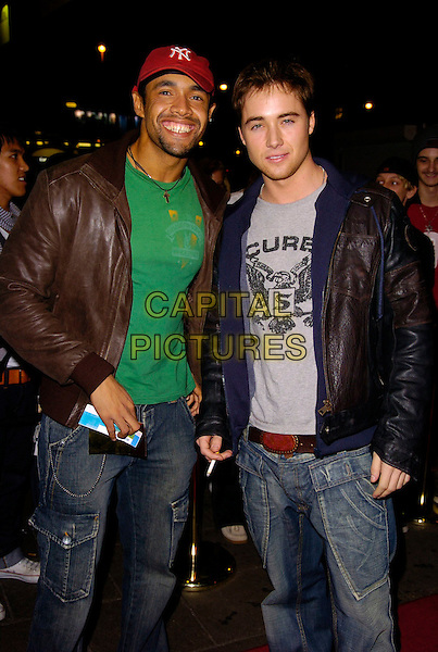 LEON LOPEZ & MARCUS PATRIC.The Sugababes new album launch & concert at the Dominion Thatre, London, UK..October 29th, 2006.Ref: CAN.full length brown black leather jacket jeans denim red baseball cap.www.capitalpictures.com.sales@capitalpictures.com.©Can Nguyen/Capital Pictures