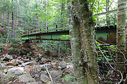 Footbridge which crossed Black Brook in the Pemigewasset Wilderness in Lincoln, New Hampshire. This steel bridge was dismantled in 2010, and no longer exists. It was located next to Trestle 16 of the East Branch & Lincoln Railroad.